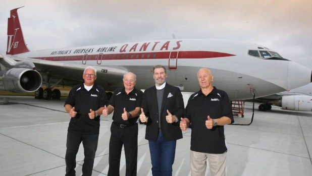 John Travolta officially hands over his Boeing 707 to HARS members Peter Elliott (left), John Dennis and Frank Bowden at ...