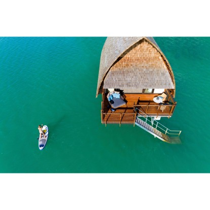 """While the over-water villas give the resort a """"Bora Bora"""" look, in truth the water is nowhere near as inviting as what ..."""