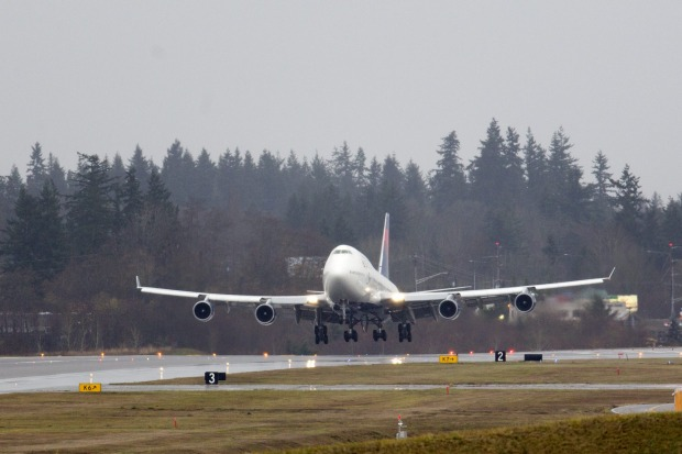 <b>Delta's last 747 jumbo jet's farewell tour:</b> A Delta 747 filled with employees and customers arrives at Boeing's ...