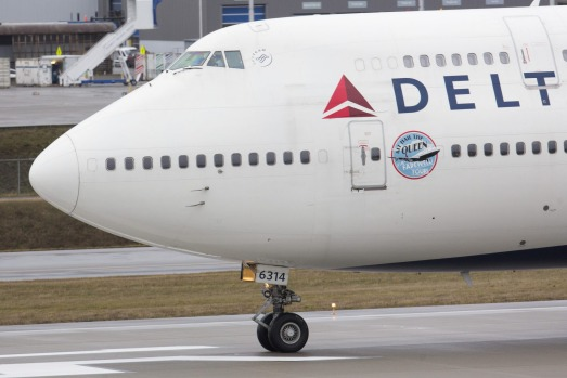 A Boeing Co. 747-400 airplane operated by Delta Airlines Inc. lands at Paine Field in Everett, Washington, on Monday, ...