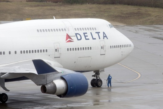 A Delta 747 filled with employees and customers arrives at Boeing's plant in Everett in the first in a series of ...