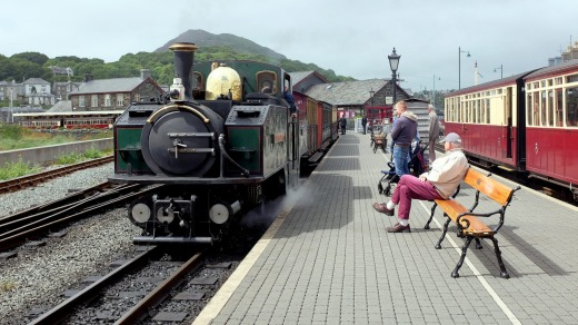 A Ffestiniog train about to leave the station shared by the Welsh Highland railway at Porthmadog.
