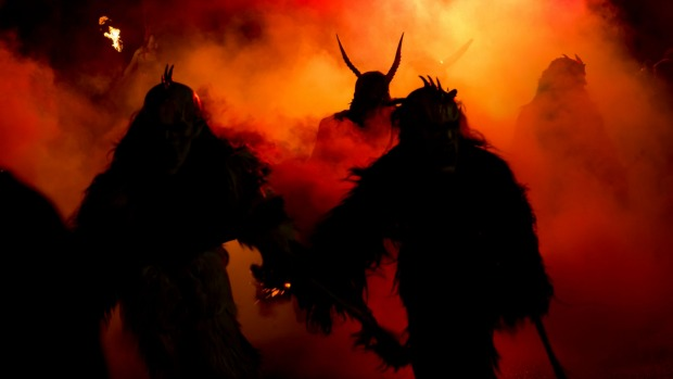 Krampus figures terrorize the streets during a December 5 parade.