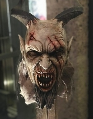 A battle-scarred Krampus mask ready for action at the workshop in Salzburg.