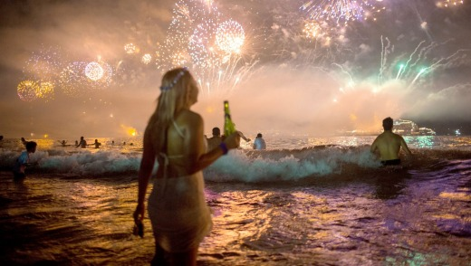 Fireworks light the sky over Copacabana beach during New Year's Eve celebrations in Rio de Janeiro, Brazil, Thursday, ...