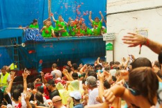 Beginning of La Tomatina festival - tomatoes madness in August 28, 2013 in Bunol, Spain. Battle of tomatoes at street of ...