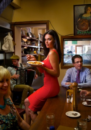 Pellegrini's, with its long bar and red vinyl stools running the length of the cafe, opened in 1954. Model: Monika ...