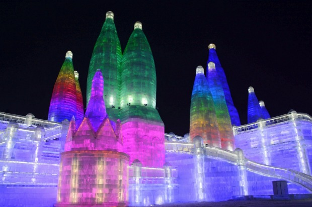 Tthe attractions are lit at the Harbin International Ice and Snow Festival in Harbin in northeastern China's ...