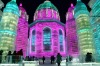 Visitors walk through the attractions at the Harbin International Ice and Snow Sculpture Festival in Harbin in ...
