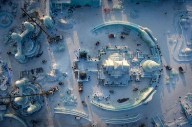 An aerial view taken with a drone shows the construction site for the Harbin Ice and Snow World in Harbin in ...