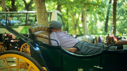 Taking a siesta in a carriage in Seville, Spain.