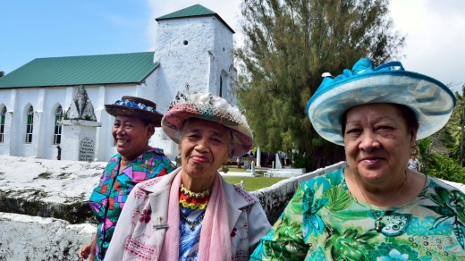 Women coming out of church after a Sunday service.The dominant religion in the Cook Islands is Christianity. The first ...