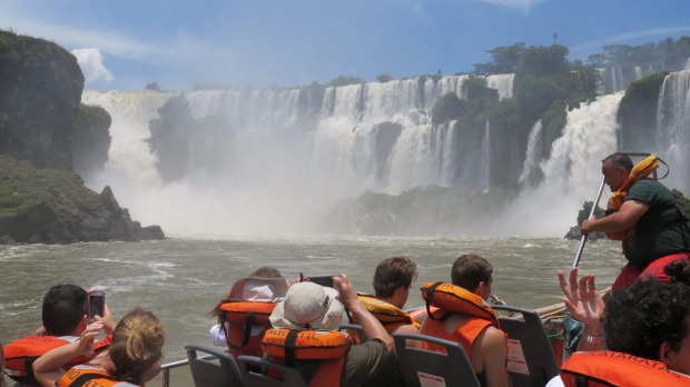 A boat trip takes visitors into the pounding heart of the Iguazu Falls.
