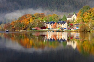 The ptcture book perfect town of Kenmore reflected on Loch Tay.