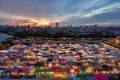 The colorful Ratchada Rot Fai Train Market at sunset, Bangkok.