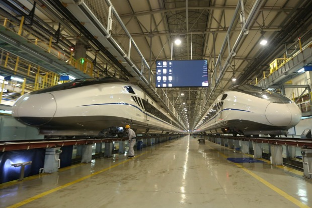 A Chinese mechanician checks a CRH (China Railway High-speed) bullet train.