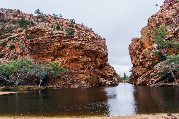 ELLERY CREEK- High red cliffs, a large waterhole and a sandy creek fringed by gums makes this one of the prettiest ...
