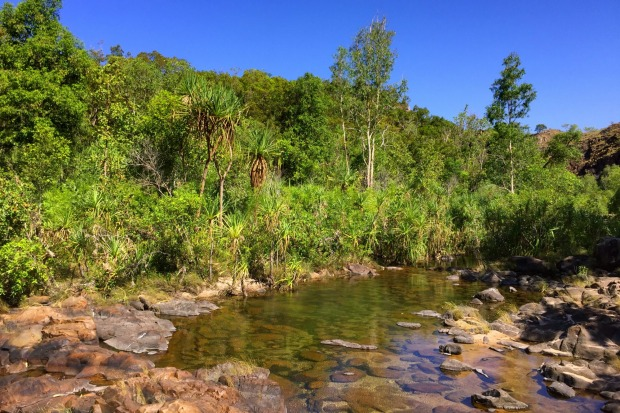 MAGUK- An emerald pool, screened by pandanus palms, misted by a waterfall and circled by some of the oldest rocks in the ...