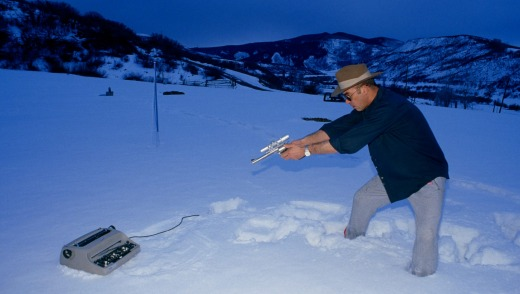 Hunter S. Thompson shooting his IBM typewriter in the Aspen snow.
