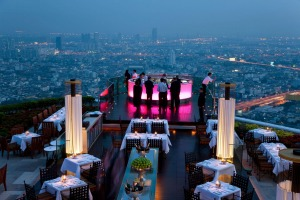 A view over open air-bar Sirocco Sky Bar and Bangkok in the evening, from State Tower, 247m, The Dome, Bangkok, Thailand