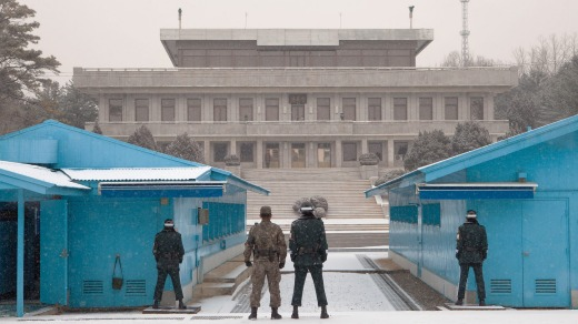Soldiers stand guard at the Joint Security Areabetween North and South Korea. The JSA was created in 1953 as a neutral ...