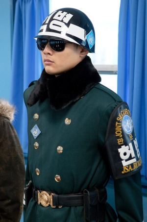 A South Korean soldier stands guard in a Joint Security Area conference room.