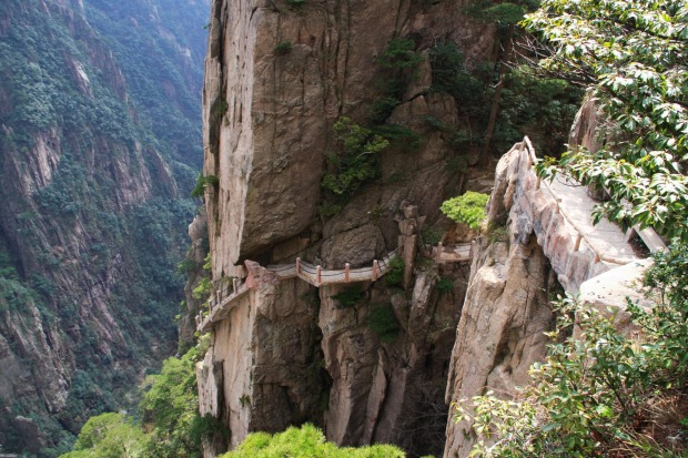 WALK OF FAITH: WHERE Tianmen Mountain National Forest Park, Hunan Province, China. HEIGHT 1400 metres above sea level. ...