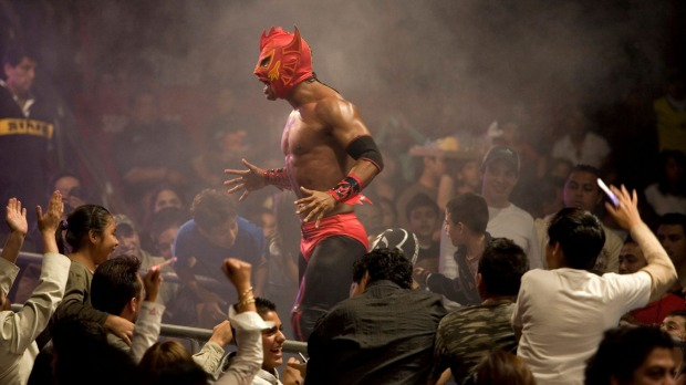 A lucha libre wrestler shouts to the crowd at Arena Mexico.