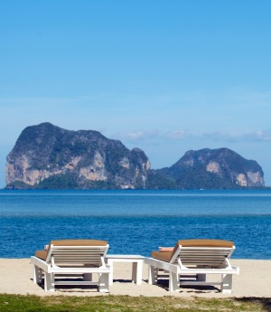 Sunloungers with an island-dotted sea.