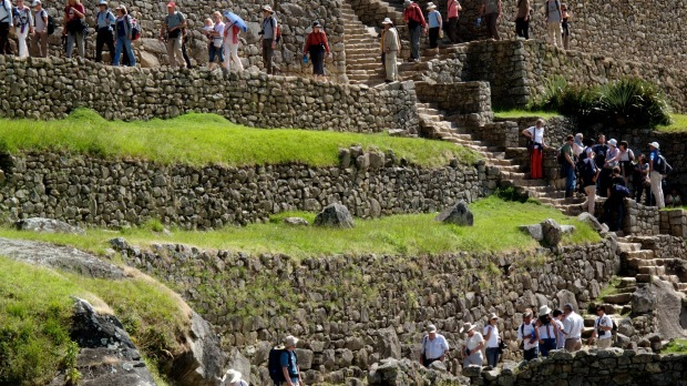 Crowds visit the ancient ruins at Machu Picchu near Cusco in Peru.
