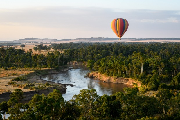 MASAI MARA, KENYA: Drift in a hot air balloon over one of Africa's most spectacular wildlife parks, looking out for ...