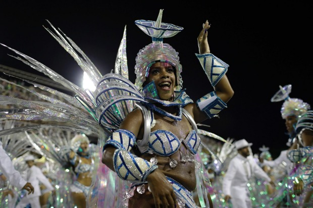 Carnival performers from Rio's samba schools celebrate at the Sambadrome. This year women's groups are highlighting the ...