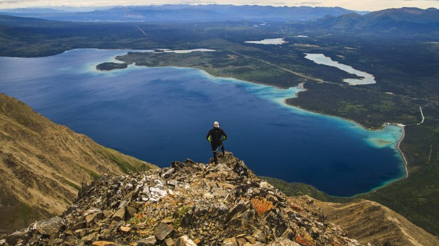 A hike to King's Throne summit in Saint Elias Mountains in Kluane National Park, Yukon, Canada, rewards you with a ...