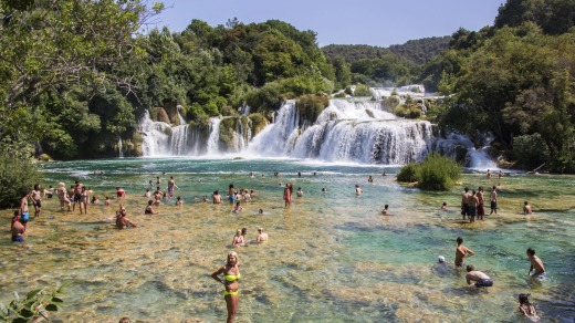 Tourists swim in the Krka National Park in Croatia.
