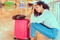 Woman at airport stranded after flight cancelled generic