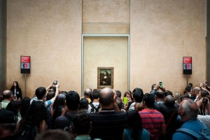 Crowds surround the Louvre's most famous exhibit.