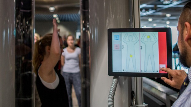 A passenger is screened using a full body scanner at the airport in Duesseldorf, Germany.
