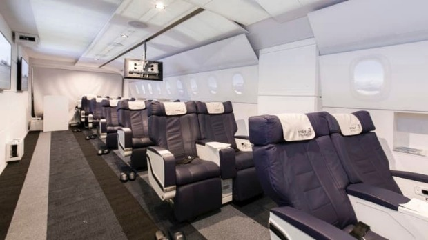Passengers are seated in Airbus A380 or A340 aircraft seats.