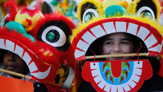 Children dressed as a dragon perform during the parade to mark Chinese new year in Chinatown district in London.