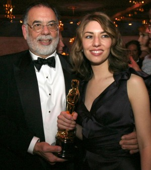 Sofia Coppola holds the Oscar she won for best original screenplay for her work on <i>Lost in Translation</i> with her ...