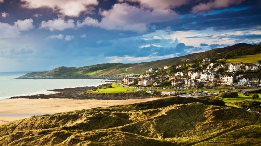 Evening light falls on the English coastal resort town of Woolacombe in Devon.
