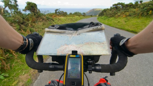 A GPS and map on a bicycle tour along the coast of Exmoor near hunters inn, Devon.