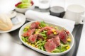 Salad of cumin spiced beef with zucchini, corn and a citris dressing will be served in economy and premium economy.