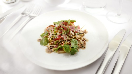Tuna poke salad with wakame and sesame soy dressing served in business.
