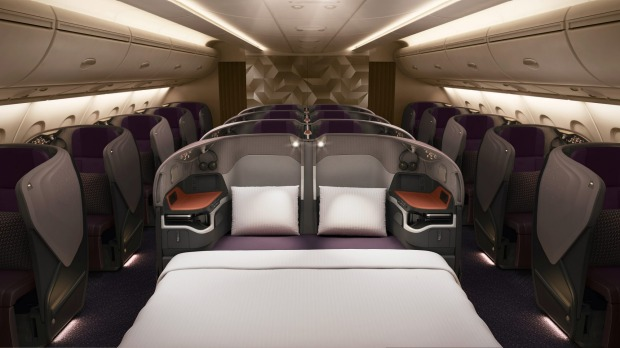 Singapore Airlines new business class seats, unveiled in 2017, allow two business class seats to convert to a double bed ...
