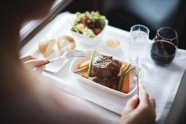 Meal service on Cathay Pacific A330 business class.