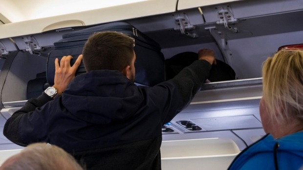 Passengers should avoid rummaging around in the overhead lockers during a long haul flight.