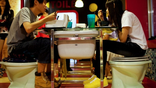 A young couple enjoys dinner at Modern Toilet Restaurant in Ximending, Taipei, Taiwan.