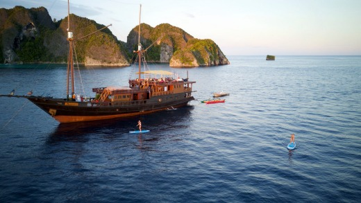 Sunset stand-up paddle boarding around the liveaboard boat.