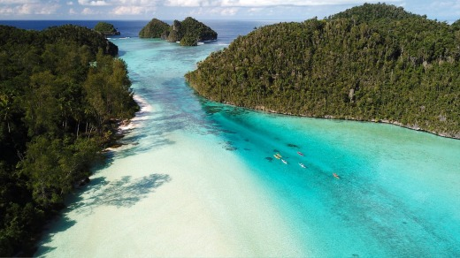 Paddling the shallows of Wayag Island in northern Raja Ampat.